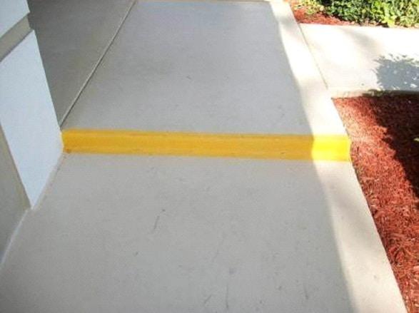 Yellow paint on sidewalk step